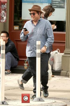 Jonah Hill in good spirits as he walks in Manhattan listening to music on his iPhone New York City, USA...