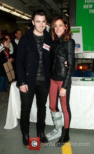 Kevin Jonas and wife Danielle Jonas host a FDNY Food Drive for Hurricane Sandy victims in Manhattan New York City,...