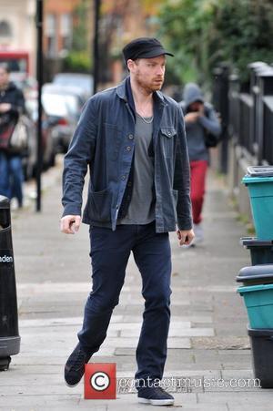 Jonny Buckland of Coldplay walking to the gym London, England - 01.12.11