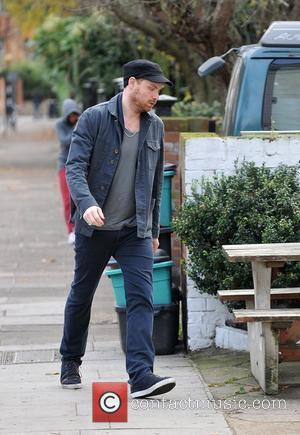 Jonny Buckland of Coldplay walking to the gym London, England - 01.12.11