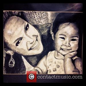 "Josh Kelley posts this pic online with the caption, '""Just finished this charcoal drawing of my wife and kid..feels good..."