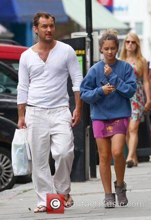 Jude Law with his daughter Iris and son Rudy walking through Primrose Hill in London London, England - 13.08.12