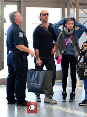 Jude Law; Rudy Law; Iris Law Jude Law with his daughter Iris and son Rudy arrive at Los Angeles International...