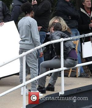 Jude Law gets punched on the film set of 'Dom Hemingway' filming on location by a canal in East London...