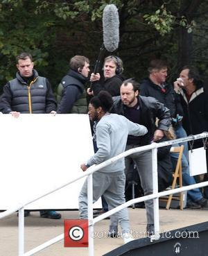 Jude Law gets punched  on the film set of 'Dom Hemingway' filming on location by a canal in East...