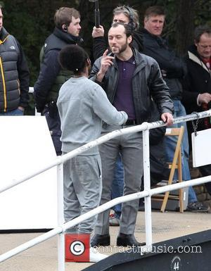 Jude Law  on the film set of 'Dom Hemingway' filming on location by a canal in East London London,...