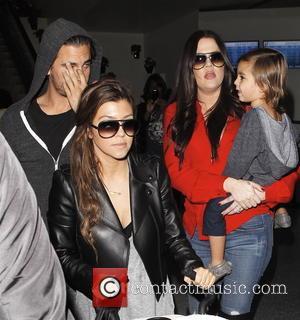 Khloe Kardashian, Mason Disick, Kourtney Kardashian and Scott Disick
