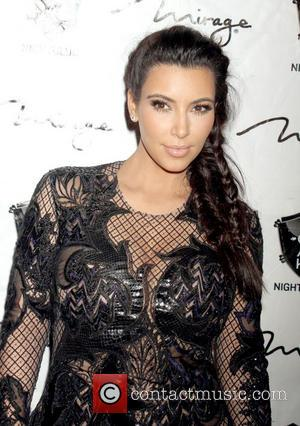 Photo: Pregnant Kim Kardashian Cradles Her Stomach
