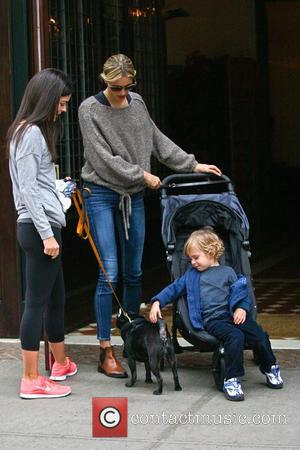 Katie Lee and Karolina Kurkova   stop to talk while her son, Archie Drury pets Joel's dog in Greenwich...
