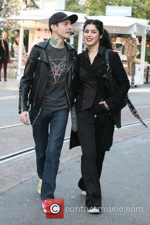 Kat Von D and Deadmaus  hold hands as they go for a stroll together at The Grove Los Angeles,...