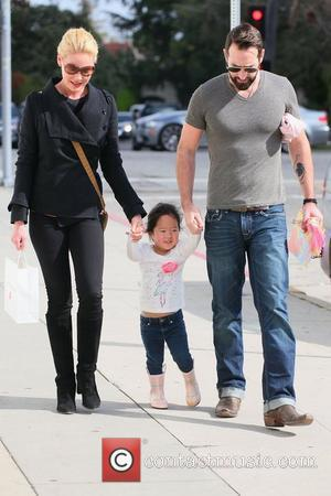 Katherine Heigl and her husband Josh Kelley with their adopted daughter Nancy Leigh Kelly are seen leaving the bungalow restaurant...