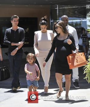 Kourtney Kardashian, Kanye West and Mason