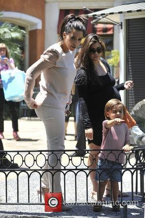 Kim Kardashian, Kourtney Kardashian and Mason