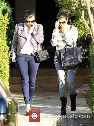 Kim Kardashian and Kourtney Kardashian  leaving a friend's house in Beverly Hills Los Angeles, California, USA - 27.01.12