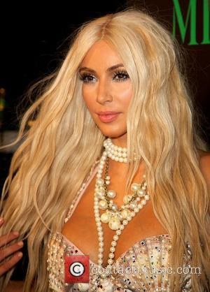 Kim Kardshian Turns Heads With Mermaid Halloween Outfit (Photos)