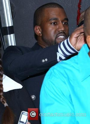 Kanye West Hugs Snapper Who Quizzed Him About Girlfriend's Ex
