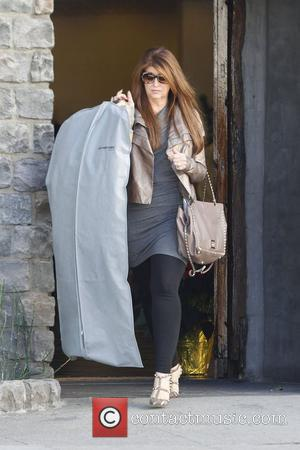 Kirstie Alley carries a garment bag while out shopping in Beverly Hills Los Angeles, California - 05.12.11