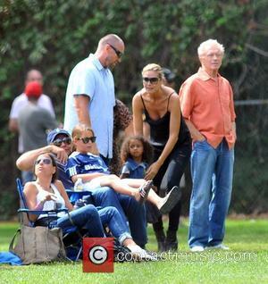 Martin Kristen, Heidi Klum and Lou Sulola Samuel