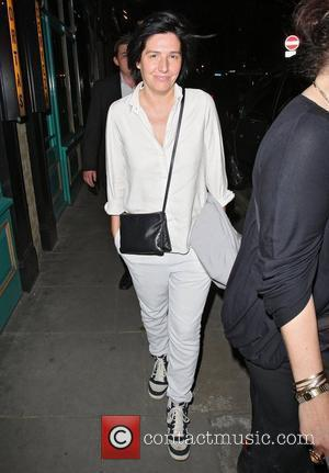 Sharleen Spiteri,  leaving La Bodega Negra restaurant in high spirits to board a hen party limo bus. London, England...