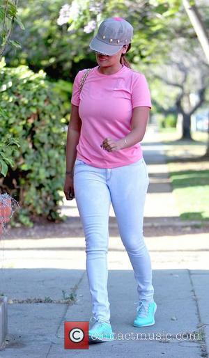 La La Anthony, formerly LaLa Vasquez, hiding under her cap as she arrives at a nail salon in West Hollywood...