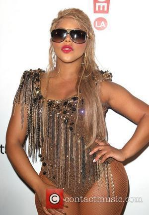 Lil Kim Gives Birth To Baby Daughter, Calls Her Royal Reign
