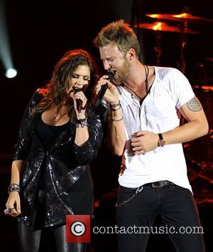 Charles Kelley and Hillary Scott of Lady Antebellum performing on stage at the HMV Hammersmith Apollo  London, England -16.07.12