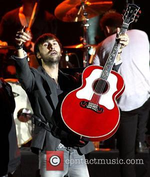 Dave Haywood of Lady Antebellum performing on stage at the HMV Hammersmith Apollo  London, England -16.07.12