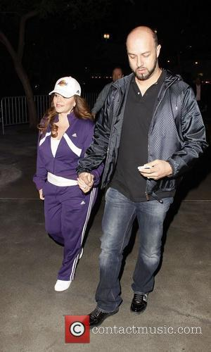 Jenni Rivera and her husband Esteban Loaiza arrives at the Staples Center for the Los Angeles Lakers v Dallas game...