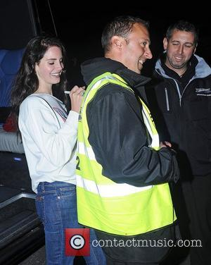 Lana Del Rey leaves Camden Roundhouse after performing at her iTunes gig. She autographed for fans including a fluorescent jacket....