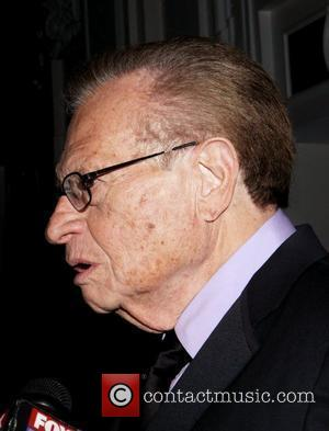 Larry King and Alec Baldwin