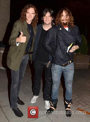 Dan Hawkins, Ed Graham and Justin Hawkins of The Darkness Celebrities outside the RTE Studios for 'The Late Late Show'...