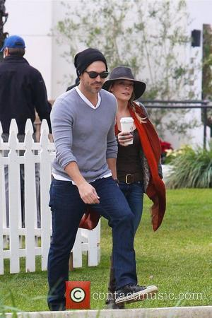 LeAnn Rimes and Eddie Cibrian arrive as a guest at a 'Cookies For Kids Cancer' charity event in Malibu Malibu,...