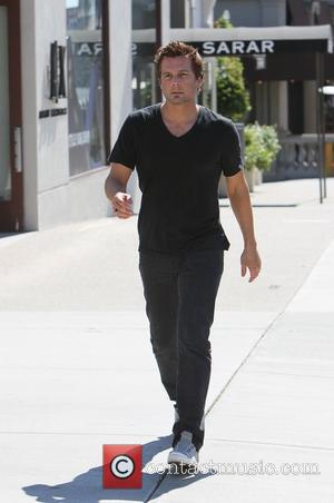 Len Wiseman window shopping on Sunset Plaza stopping at Zadig Voltaire before returning to his car empty handed. Los Angeles,...