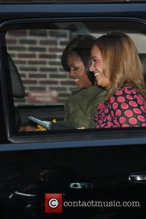 First Lady Michelle Obama leaving The Ed Sullivan Theater for 'The Late Show with David Letterman'  New York City,...