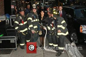 Salma Hayek poses with members of the FDNY 'The Late Show with David Letterman' held at the Ed Sullivan Theatre...