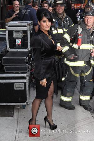 Salma Hayek posing with firefighters 'The Late Show with David Letterman' held at the Ed Sullivan Theatre - Arrivals New...