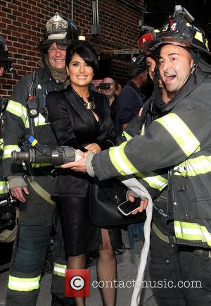 Salma Hayek posing with firemen 'The Late Show with David Letterman' held at the Ed Sullivan Theatre - Arrivals New...