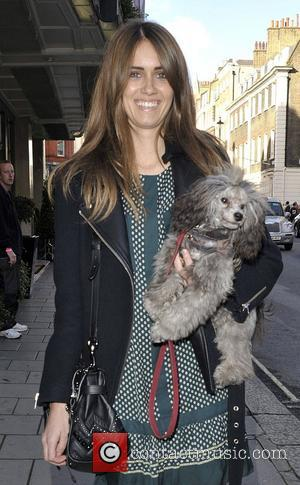 Jade Williams aka Sunday Girl with her dog. London Fashion Week Spring/Summer 2013 - Mulberry - Outside Arrivals London, England...