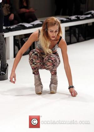 Alice Dellal drops her cigarette during rehearsals London Fashion Week Spring/Summer 2013 - Pam Hogg - Rehearsals London, England -...