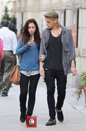 Lily Collins and Jamie Campbell Bower out and about in Toronto Toronto, Canada - 14.08.12