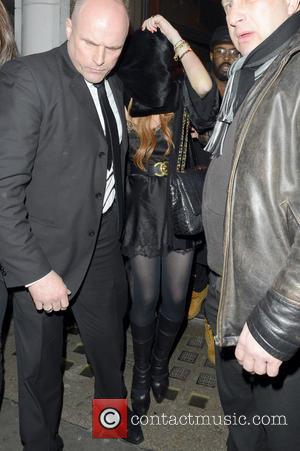 Lindsay Lohan Linsday Lohan leaving a London club, sporting a brusied elbow in London  Featuring: Lindsay Lohan Where: London,...