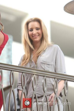 Lisa Kudrow makes an appearance on 'Extra' at The Grove in Hollywood Los Angeles, California - 30.01.12