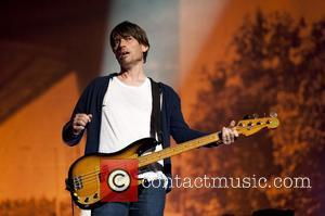 Alex James of Blur performs on stage during the BT London Live closing ceremony concert at Hyde Park London, England...