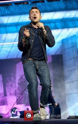 Damon Albarn of Blur performs on stage during the BT London Live closing ceremony concert at Hyde Park London, England...