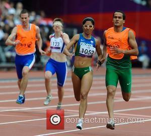 Jerusa Geber Santos of Brazil and her guide Luiz Henrique Barboza Da Silva London 2012 Paralympic Games - Women's 200m...