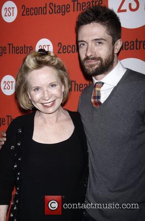 Debra Jo Rupp and Topher Grace