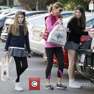 Lori Loughlin returns to her car with daughter's Isabella Rose and Olivia Jade after shopping at Bristol Farms Los Angeles,...