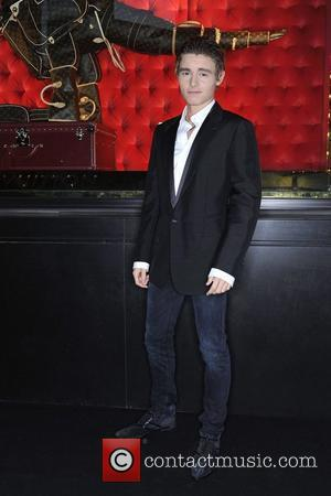 Callan McAuliffe arrives at the instore cocktail party celebrating the opening of the Louis Vuitton Australian flagship 'Maison' store. The...