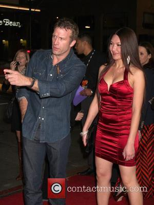 Thomas Jane and guest HBO's 'Luck' Los Angeles premiere held at Graumans Chinese Theatre Hollywood, California - 25.01.12