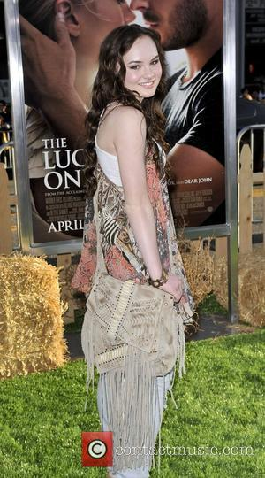 Madeline Carroll,  at the premiere of 'The Lucky One' held at Grauman's Chinese Theatre Hollywood, California - 16.04.12